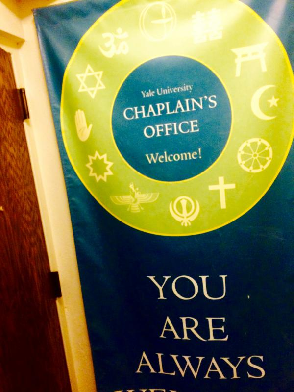 Banner outside chaplain's office featuring the Seal.